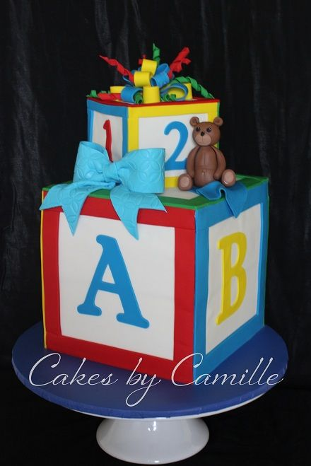 Building blocks baby shower cake in primary colors