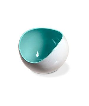 A cozy home for easy-to-lose accessories like cuff links, hair ties, or safety pins, this white ceramic bowl pops with a brightly colored interior. #goodhousekeeping #happyroom