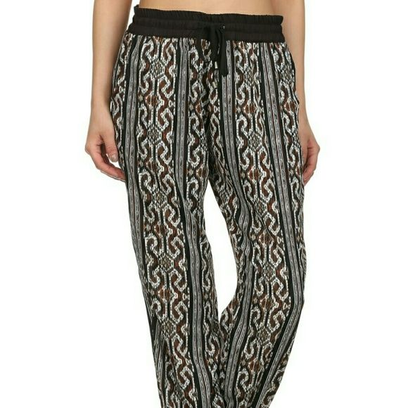 Print joggers pants. Print joggers pants with drawstring waist and cuffed bottom. New. Sizes:Small-Medium-Large-XLarge Uncommon Pants Track Pants & Joggers