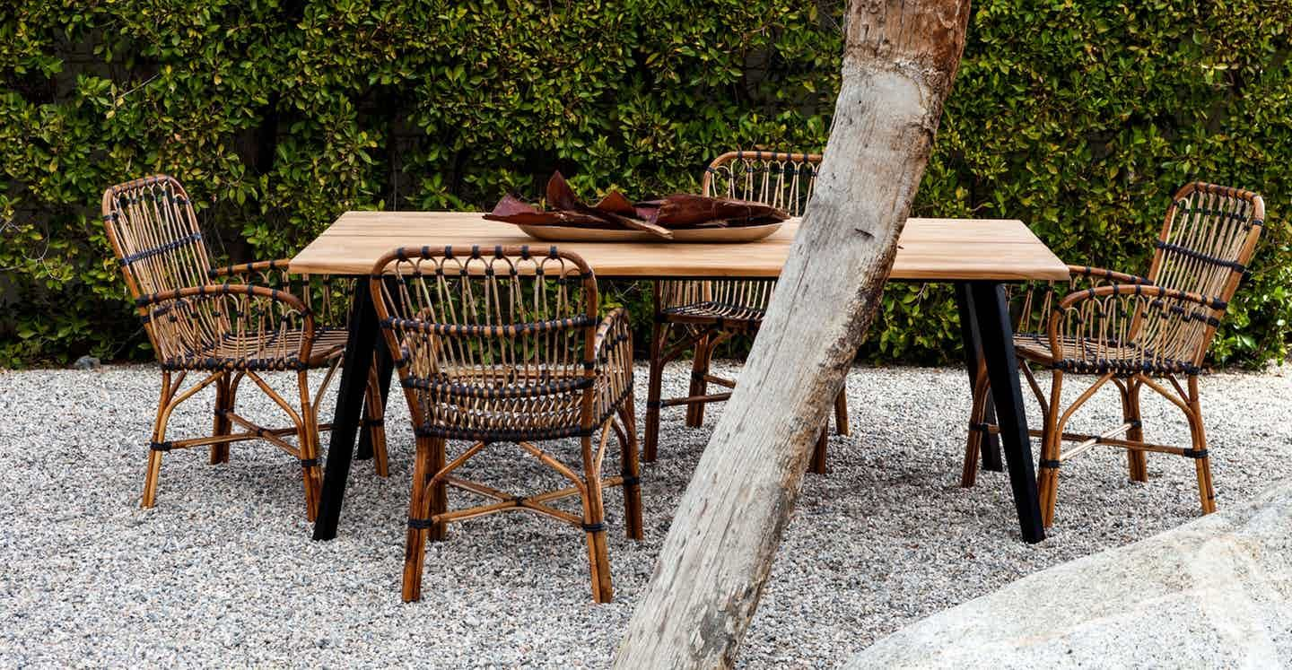 Organic lines make the lisse table a chic place for casual gatherings its thick irregular edged teak top is supported by galvanized powder coated steel