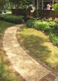 Installation Of A Pea Gravel Walkway Note The Containment