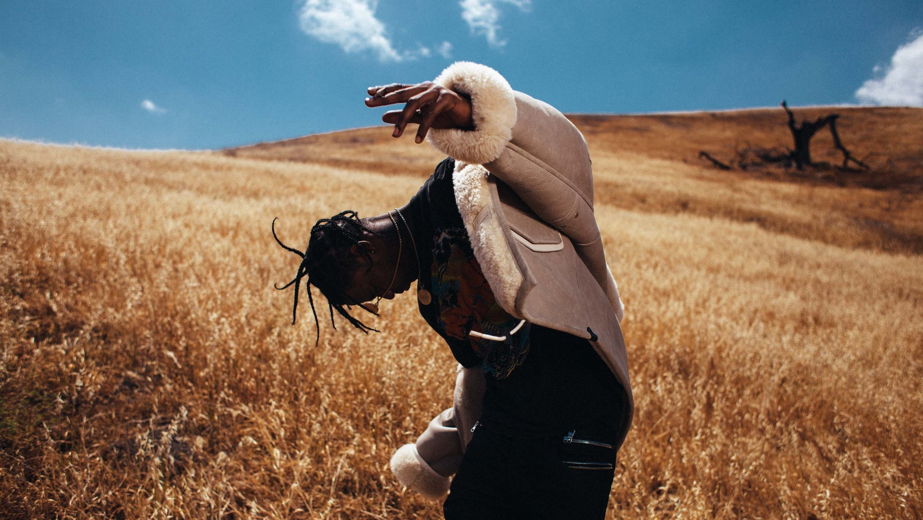 ic: Travis Scott in an oversized beige shearling jacket during the Rodeo (2015) era