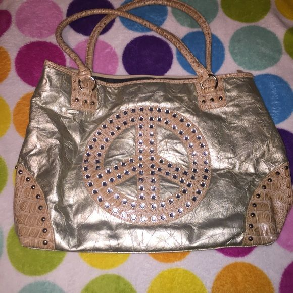 Peace Sign Bling Purse Peace sign with sparkles! Has a zipper and some pockets inside (includes a phone pocket). Can't remember what brand it is. Never used this purse just was in the back of my closet. Great condition. Comment or make an offer about price! Other Bags Hobos