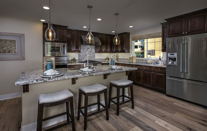 Gourmet kitchen with gorgeous slab granite countertops for House plans with gourmet kitchens