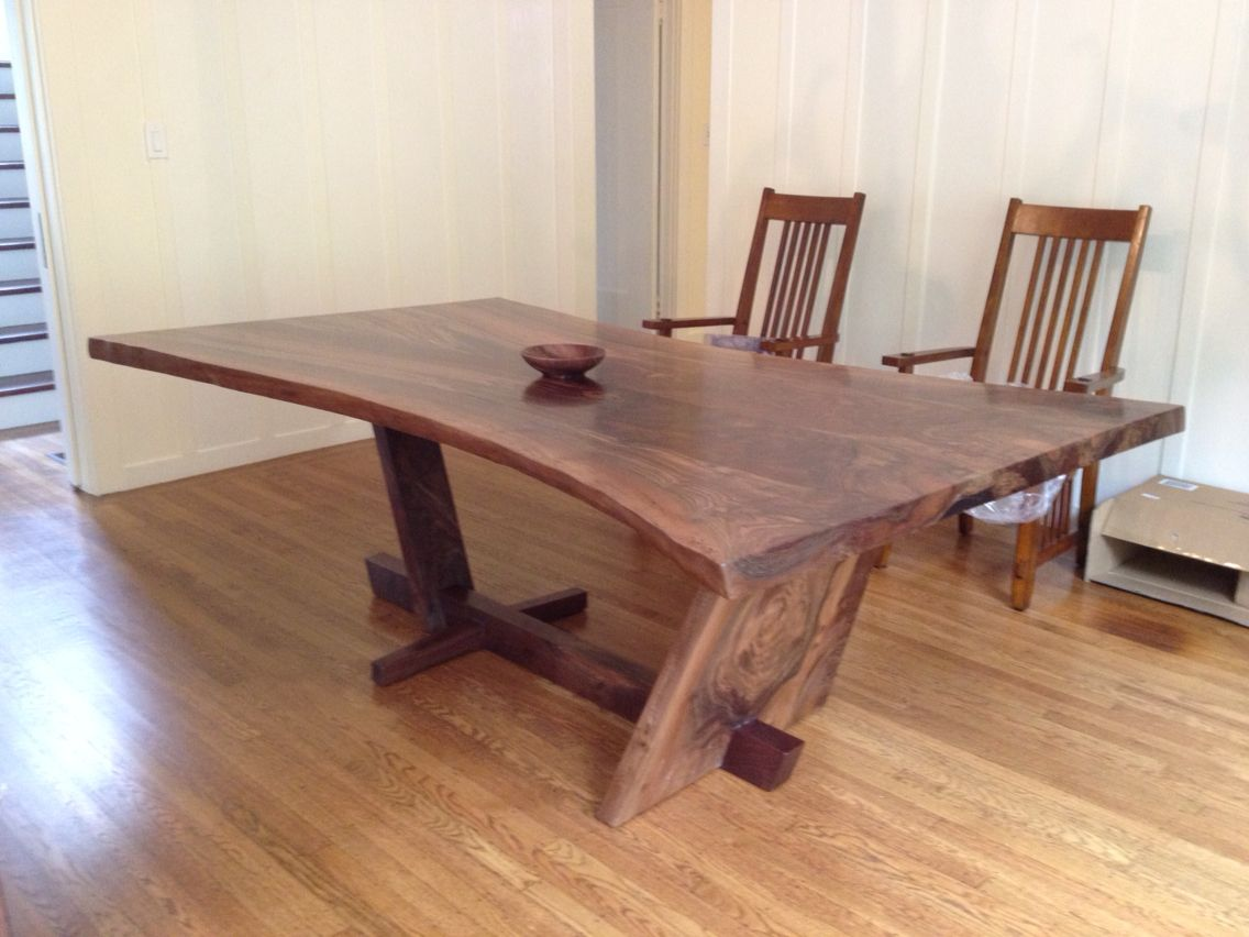 Hourglass Shaped Walnut Slab Dining Table With A Live Edge And A
