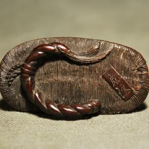 Description: a wooden Netsuke, a toad on Japanese sandal Artist: signed Kokei Date: early 19th century Size: height 1.7 cm, length 4.6 cm