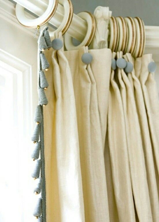 pinch pleated drapes with button and lead edge trim