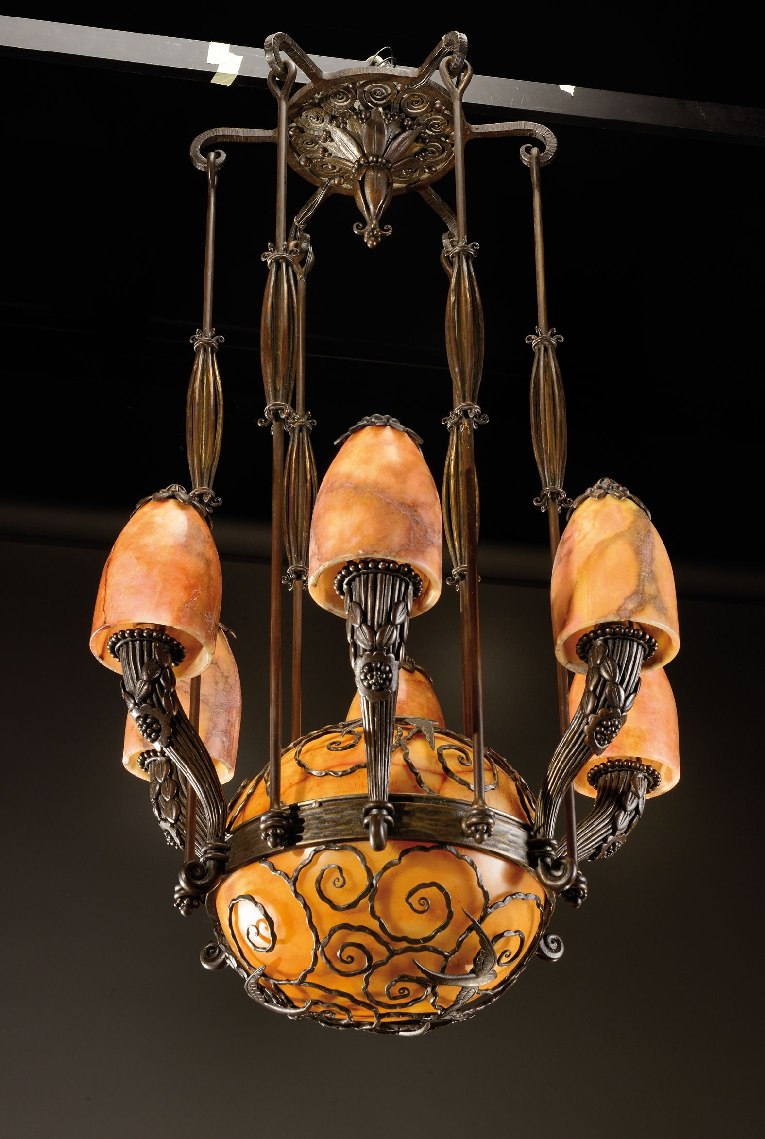 Edgar brandt 1880 1960 a large hammered wrought iron centre chandeliers arubaitofo Choice Image