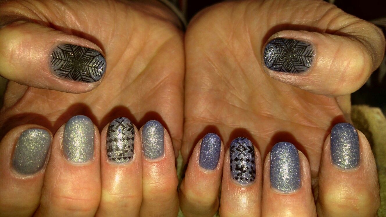 Winter nail design Acrylic nails with stamped snowflake and