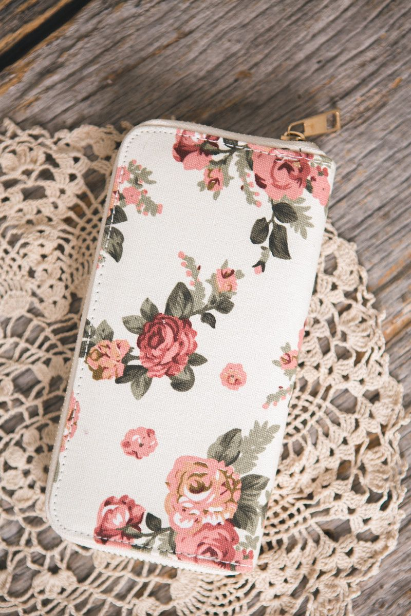 - Vintage inspired floral fabric wallets - Choose from either chocolate brown or ivory options - Black faux leather inside lining - Could be used as a wallet or small clutch purse on the go