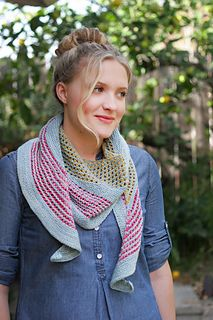 An eyelet striped crescent shaped shawl with so many color combos to choose from, great way to use up some of your scrap sock yarn.