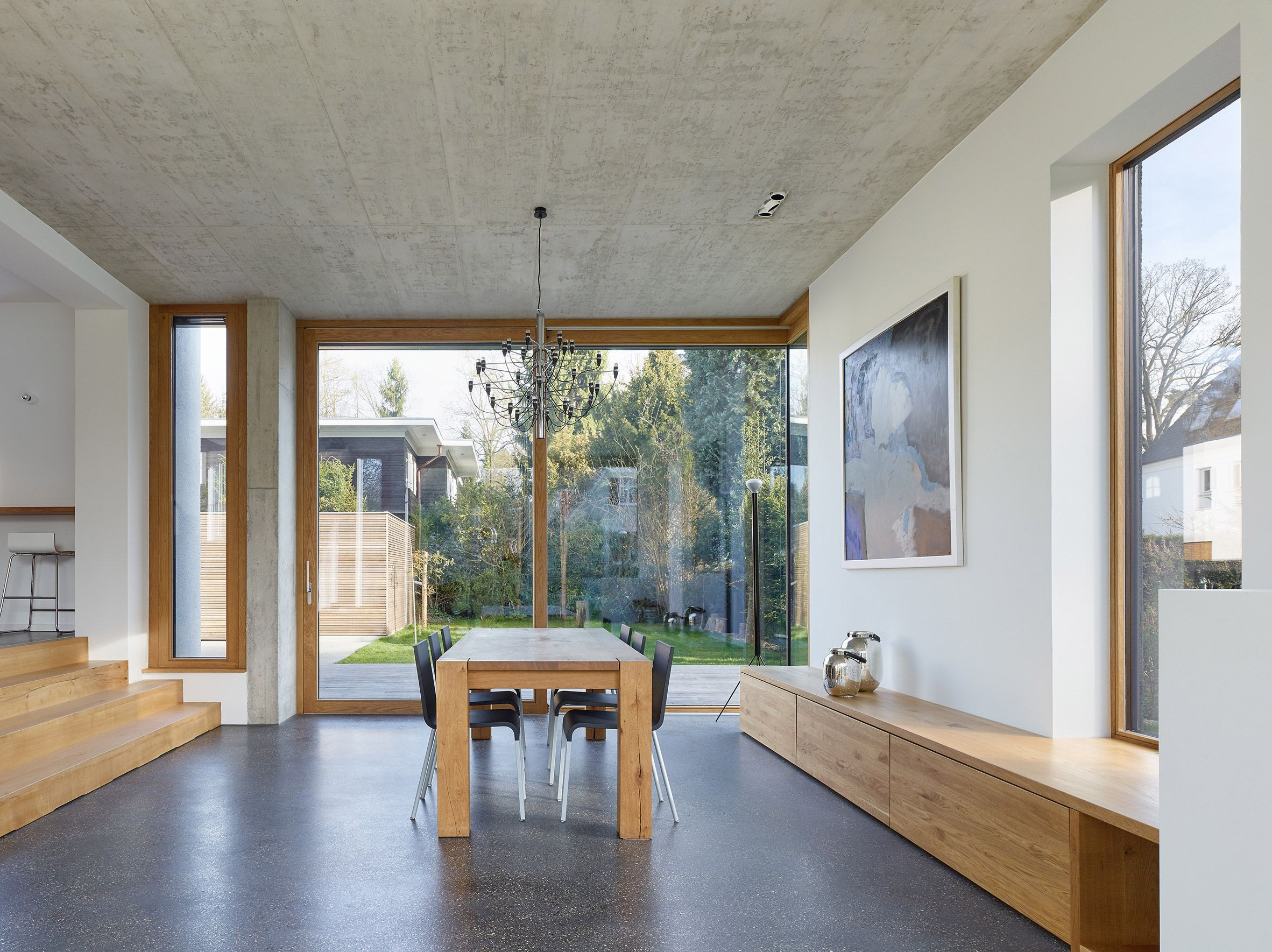 Floor To Ceiling Sliding Glass Doors Run The Length Of The Ground