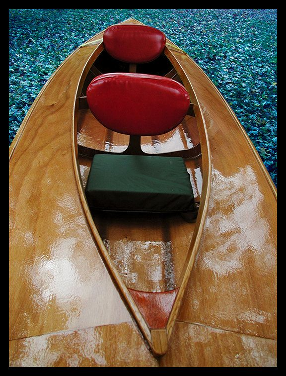 Beautiful hand-crafted touring Kayak and trailer. $3,300.00, via Etsy.