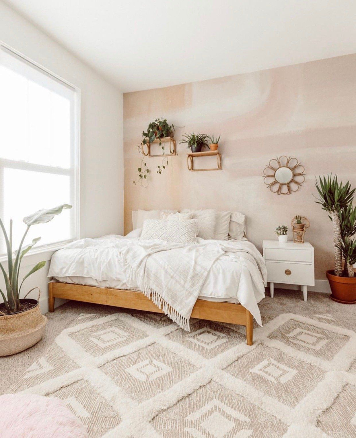 The Tawny mural contains soft-hued pinks, faded purples, and warm oranges. This stunning mural is the perfect way to bring a pop of colour to a neutral space and bring a sense of serenity to your home. Design by Joy Kinna.