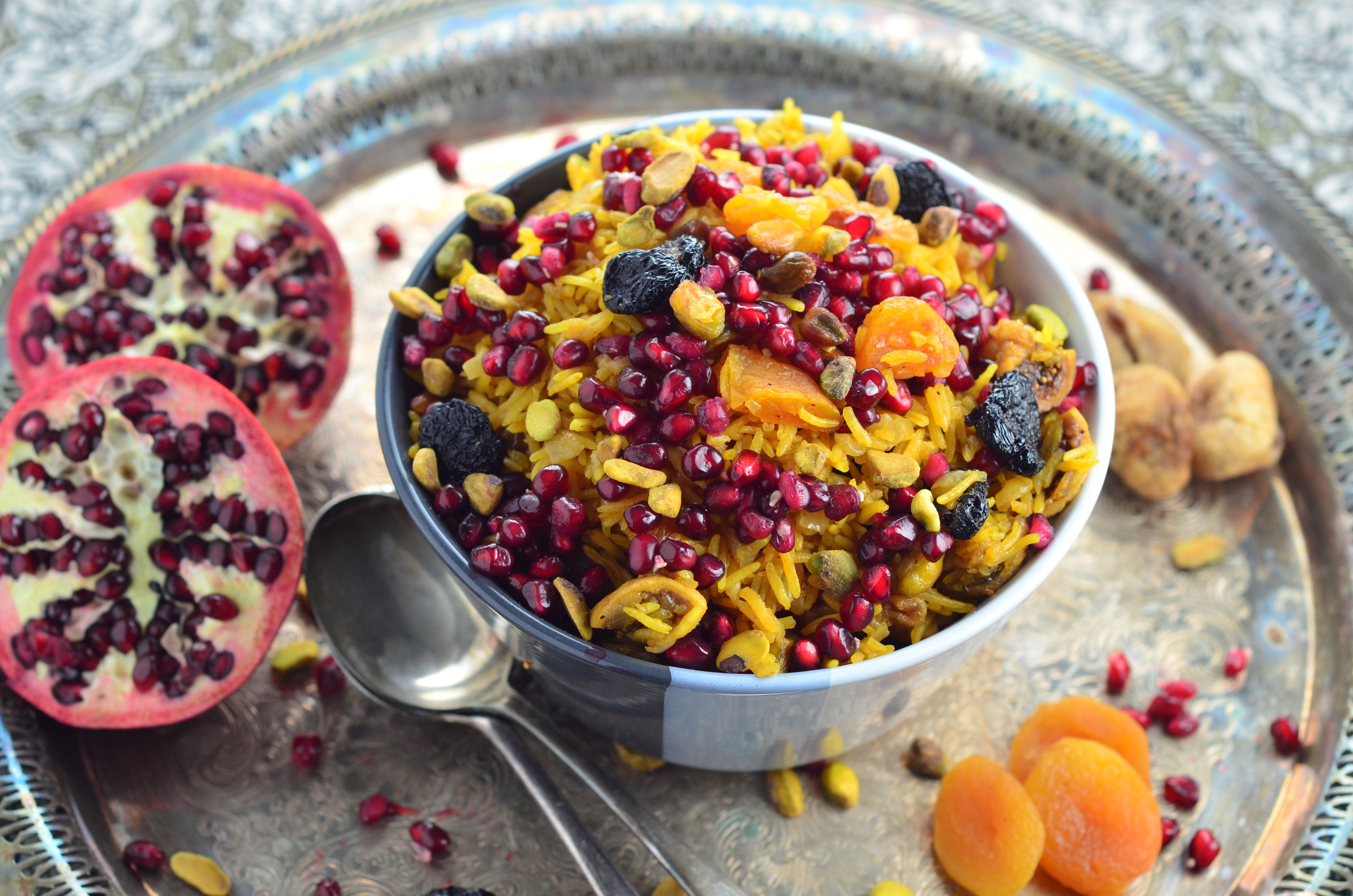 Perfect Rosh Hashanah side dish - The rice is infused with fragrant spices, sweetened with dried apricots, figs and cherries with a nice crunch form pomegranates and pistachios