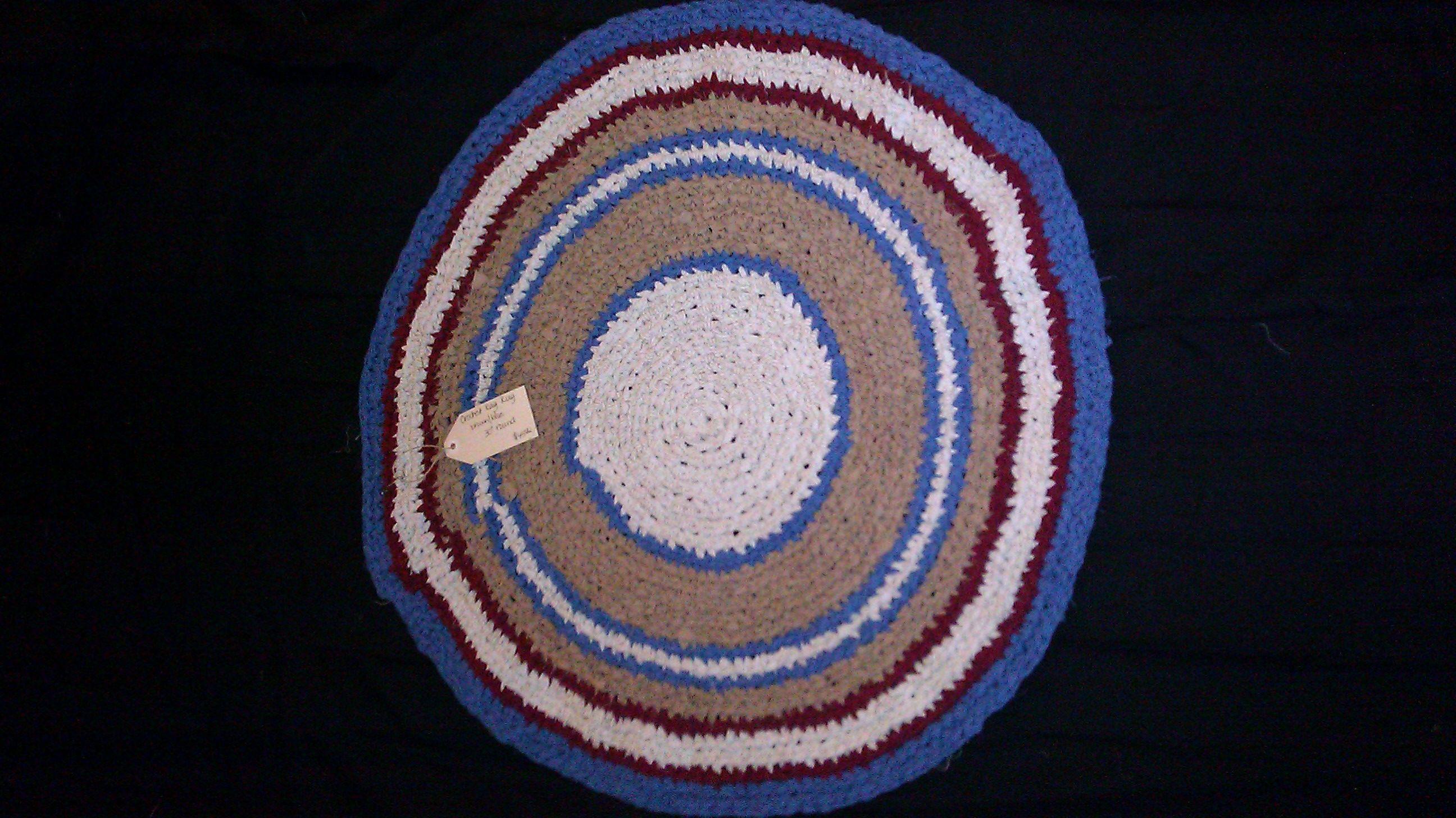 brown/blue/maroon crochet rug