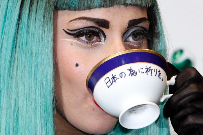 3893d2661317 Lady Gaga sips from a teacup carrying the words