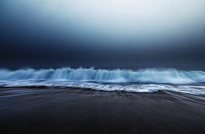 Ocean Waves and Sand Collide Together in Beautiful Seascape Photos