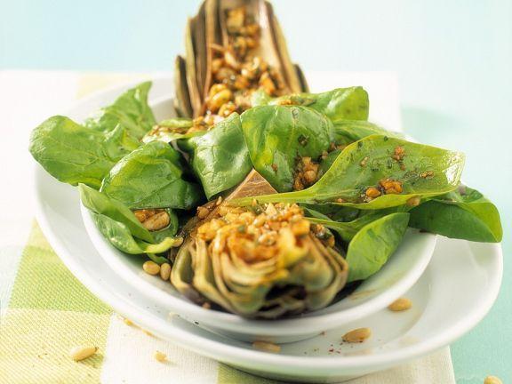 Artischocken-Spinatsalat ist ein Rezept mit frischen Zutaten aus der Kategorie Blattgemüse. Probieren Sie dieses und weitere Rezepte von EAT SMARTER!