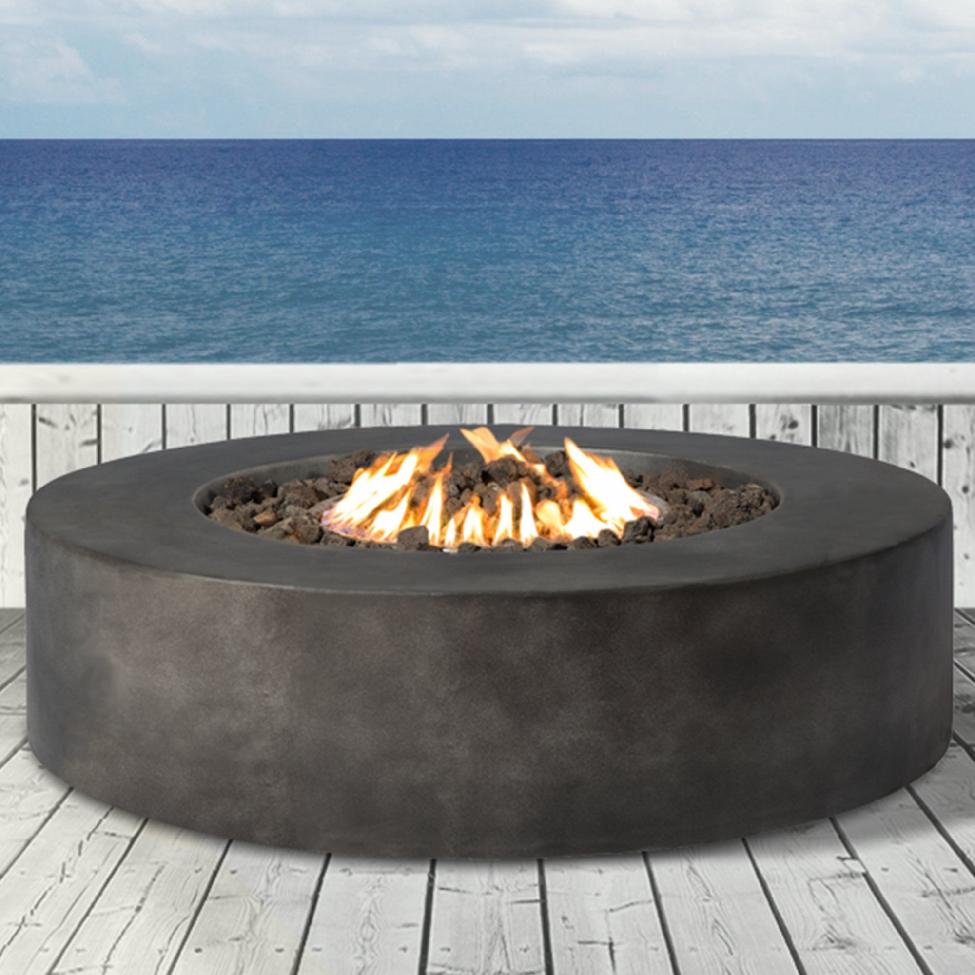 Santiago concrete propane fire pit keep warm in the winter