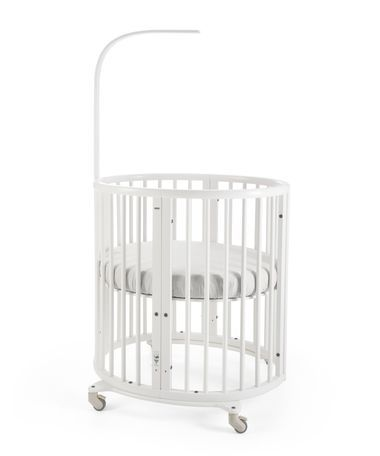 Stokke® Sleepi Mini is the perfect first bed for your baby. Its distinctive oval shape provides your baby with a sense of security by creating a cozy nest-like environment. With adjustable height positions as well as the ability to grow with your child, Stokke® Sleepi expands to accommodate the changing needs – and sizes – of the growing child while maintaining a comforting familiarity. The bed creates a small footprint in your nursery  while the lockable wheels make it easy to move from ...