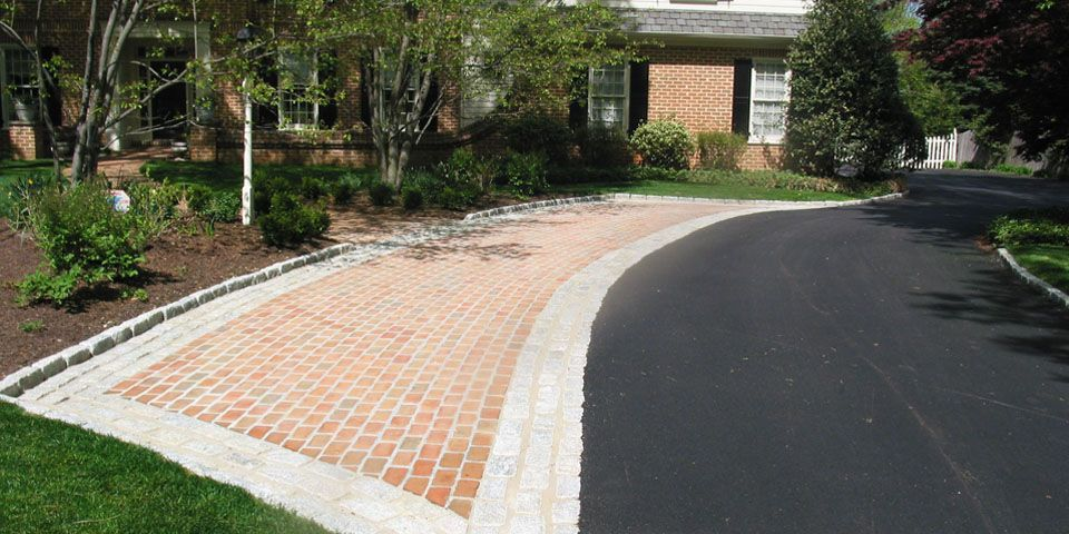Red brick driveway with cobblestone apron and edge for Driveway apron ideas