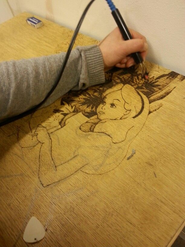 Pyrography and sketching. Vinella and krupa