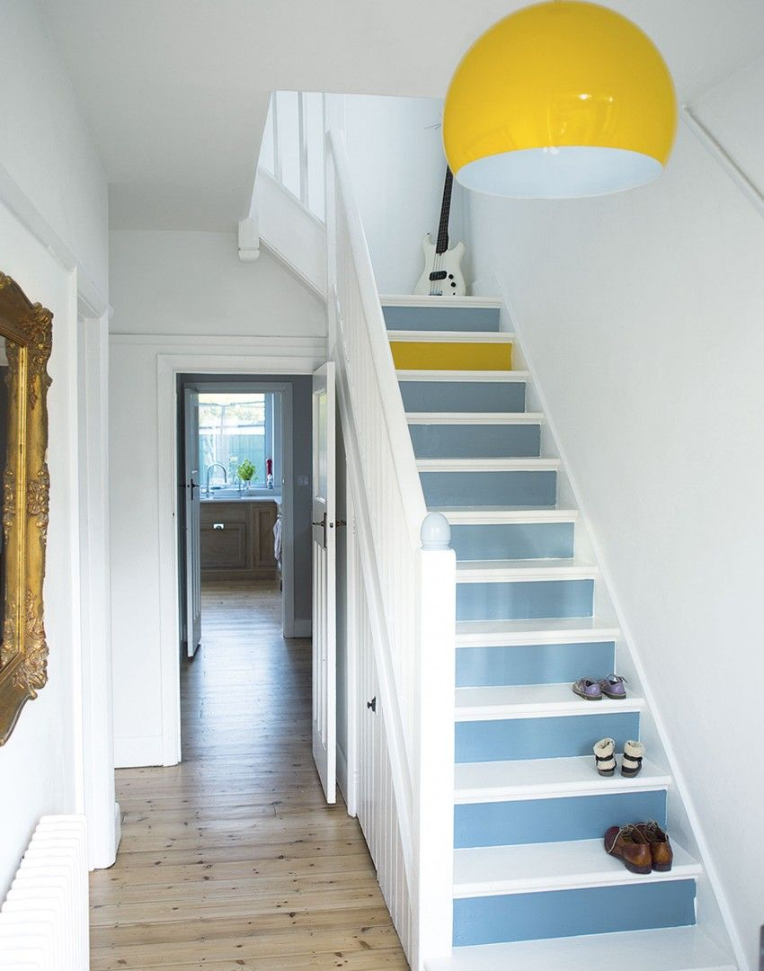 White Hallway With Painted Stairs Yellow Lamp And One Yellow Step Looks Nice