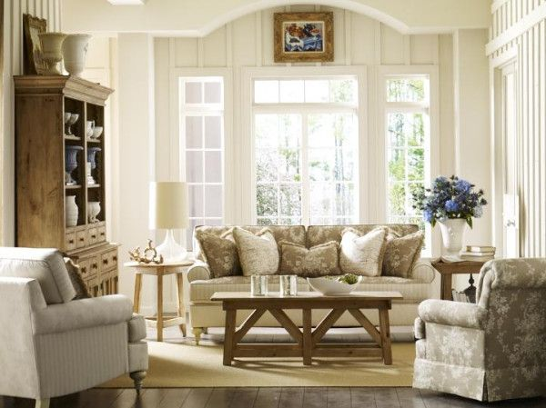 Perfect Kincaid cottage style that just glows. Wish you could curl up with a book (or ipad) on that cozy sofa?