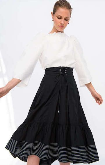 Summer outfits: A crisp white blouse and full black skirt are such a classic look.