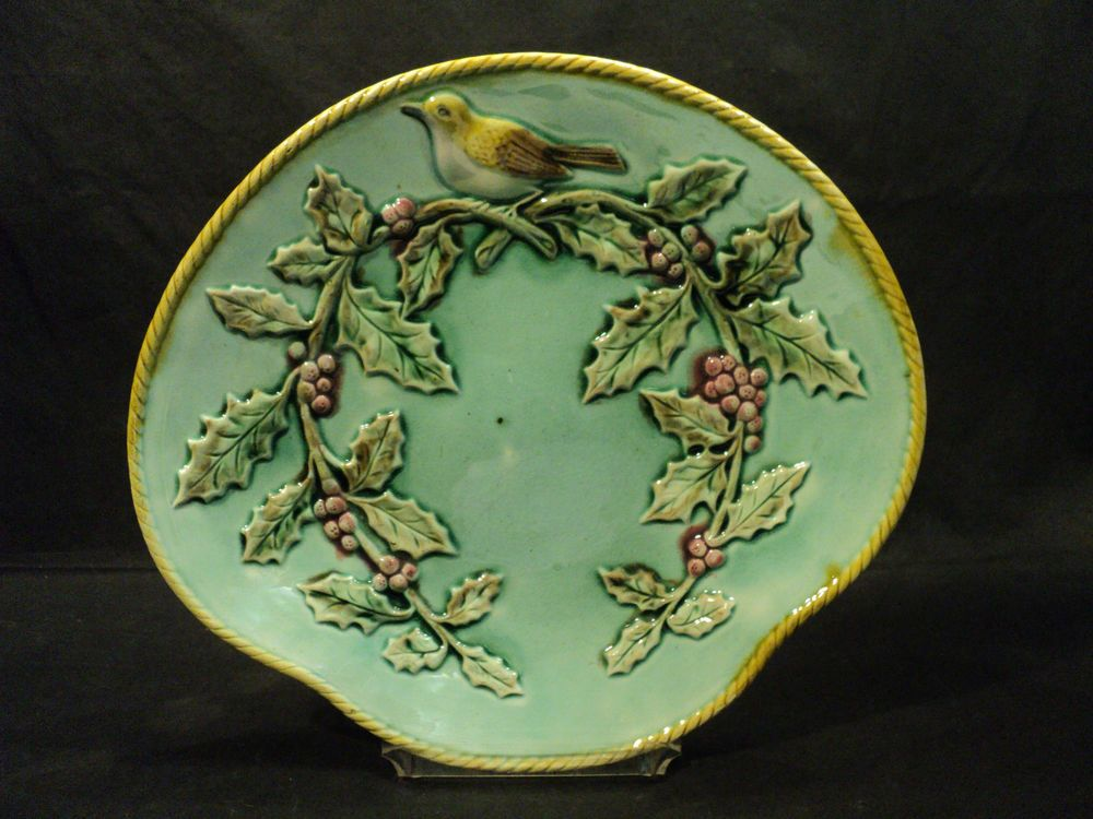This beautiful tray is guaranteed to be a piece of antique majolica and is not a reproduction. We currently have a nice selection of antique majolica available so please check our ebay store for other great items.