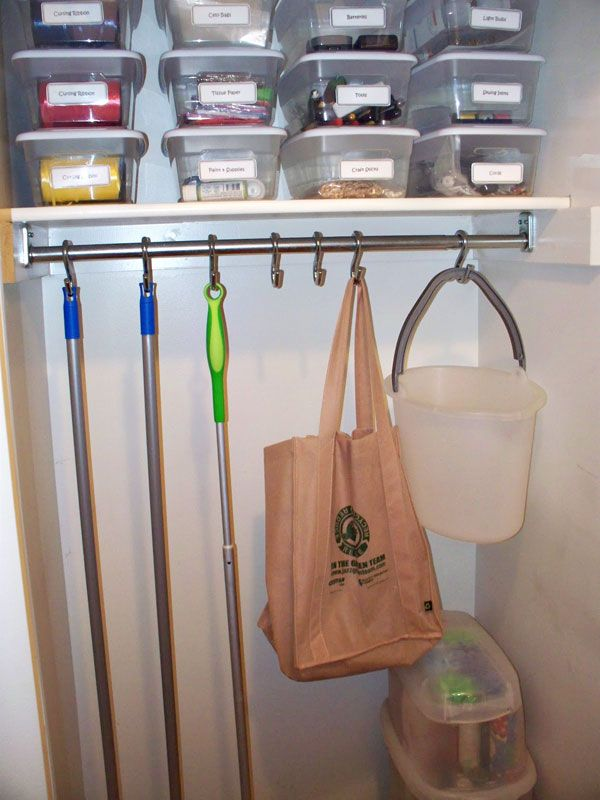 Use a couple of S-hooks to create mop/broom storage in a utility closet. & Use a couple of S-hooks to create mop/broom storage in a utility ...