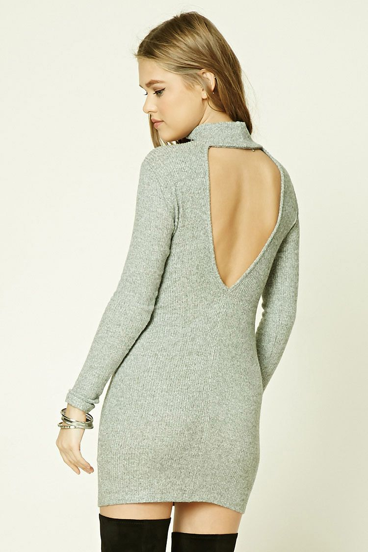 d8e253bef8 A brushed ribbed knit sweater dress featuring a mock neckline