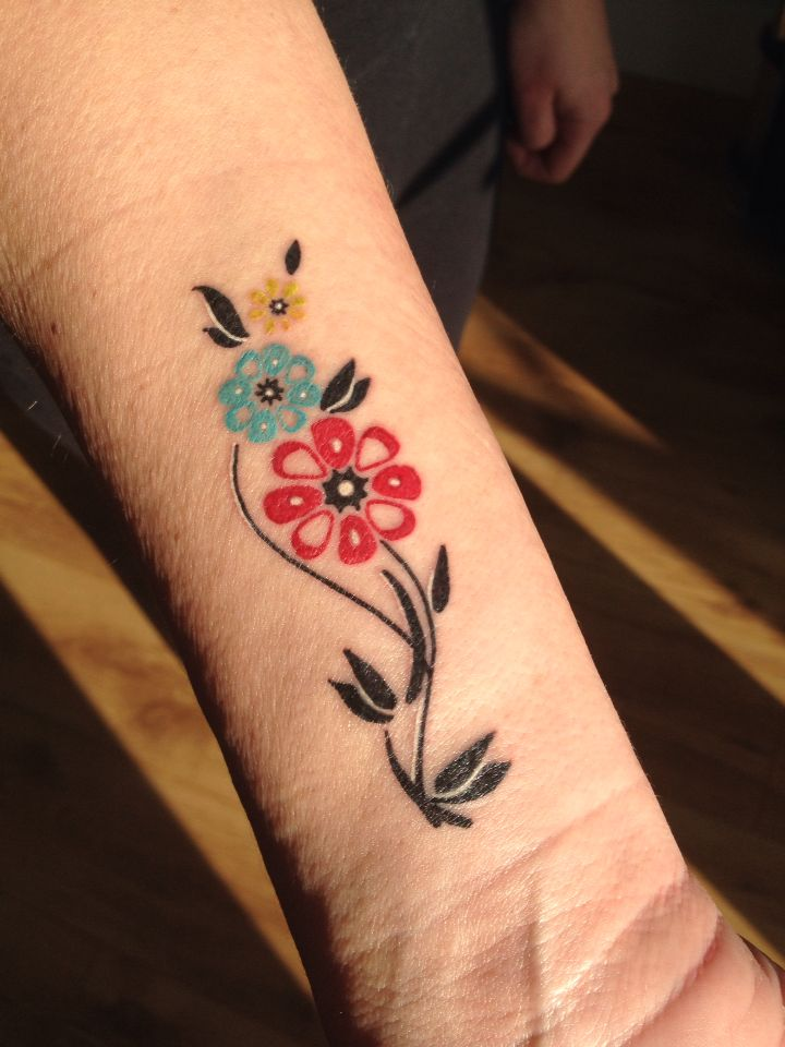 Wrist tattoo with flowers the colour of children's ...