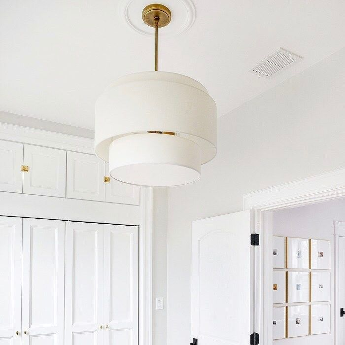 "Can you believe that this room was once dubbed ""The Scary Room"" by @yellowbrickhome? Link in profile to view the transformation of this space - thanks in part to our small Tiered drum pendant & cabinet hardware - plus enter to win $250 in Rejuvenation products to tackle your own project, scary or not. #myonepiece #hardware #pendantlighting #whiteandbrass #ybhrenovates #giveaway #homerenovation"
