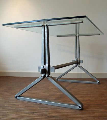Forged ironwork contemporary wedge trestle table james for Bett industriedesign