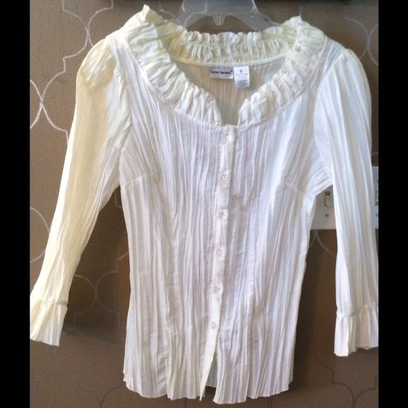 Gorgeous cream, crinkle fabric blouse. Super pretty cream colored crinkle blouse.  60% polyester/40% nylon.  Ruffled standup collar and ruffled cuffs.  2 minor stains that may be easily cleaned.  Great for work or that special occasion. Harve Benard Tops Blouses
