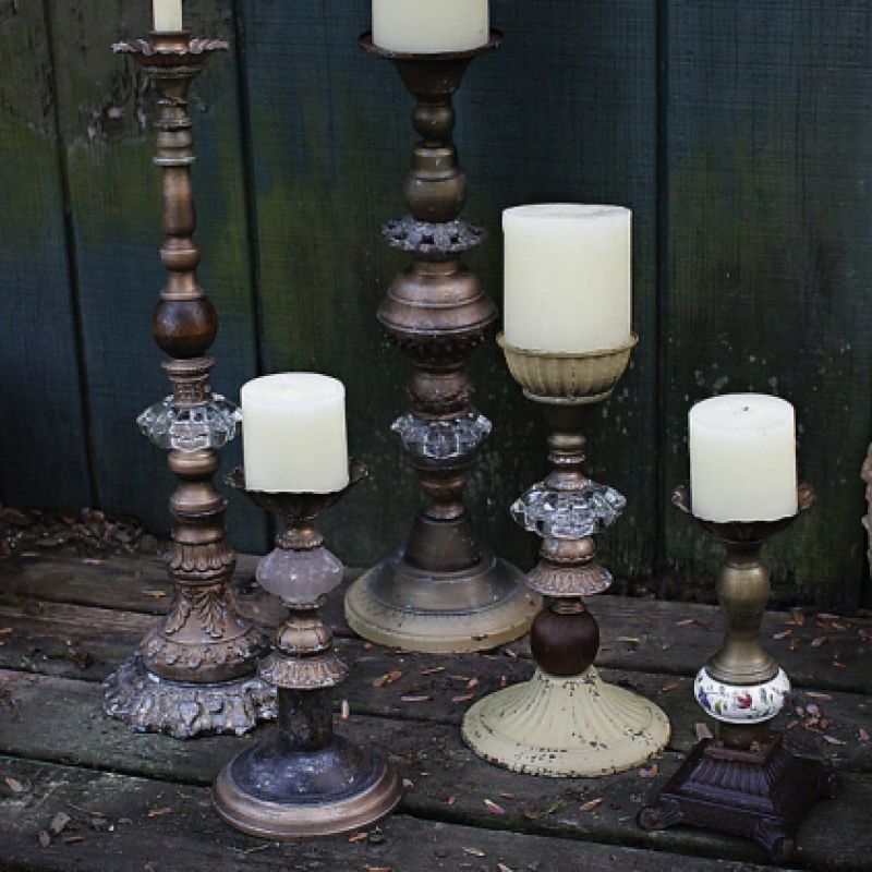 Set the mood with beautifully displayed candles using vintage style iron and resin candle pillar holders, each made from assorted vintage reproduction finds.