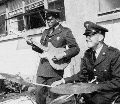 Jimi Hendrix playing guitar in US Army uniform, 1961 ...  Jimi Hendrix Army Unit