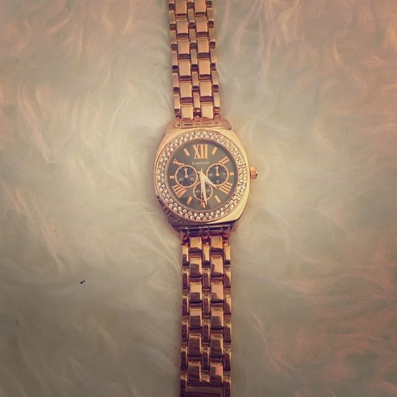 Rose gold watch Rose gold bebe watch with black face. Never warn or altered so you can remove links to your size. bebe Accessories Watches