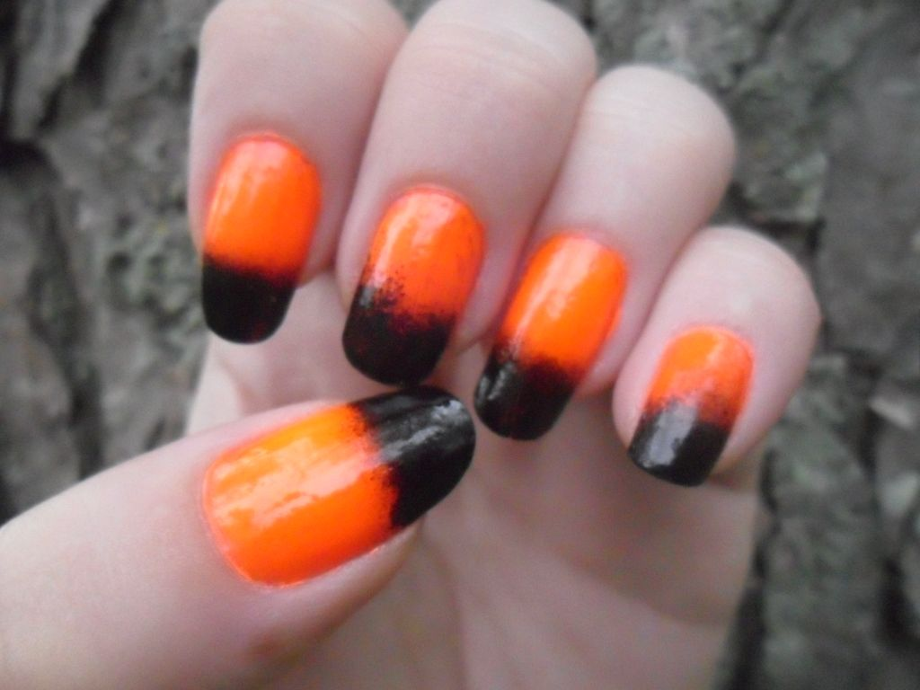 October 2012 - First Halloween-themed nails of the month!  Achieved with neon orange base and sponged on black.