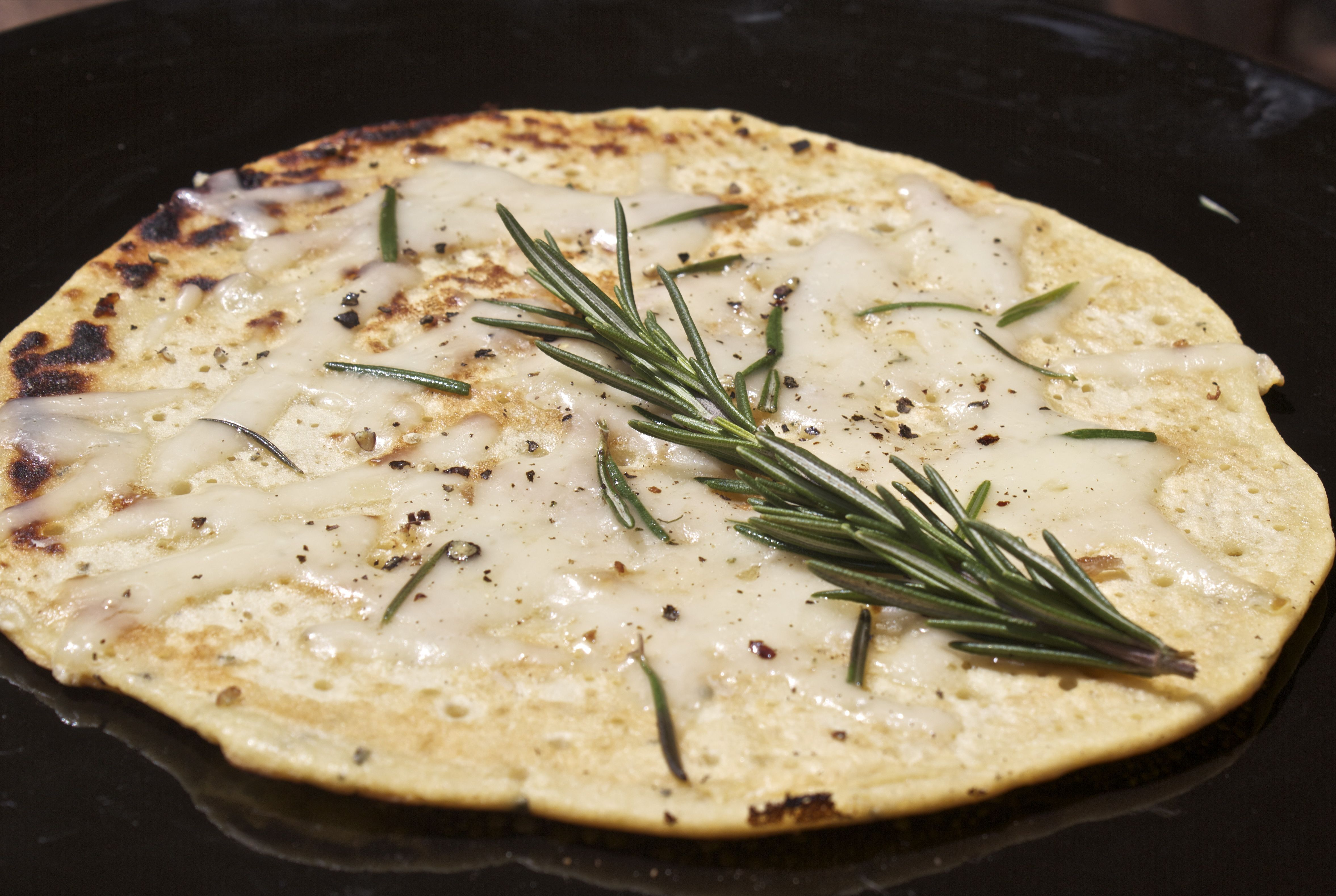 Easiest gluten free pizza base, Garlic Rosemary and Comte Socca  http://wutheringbites.co.uk/2012/06/17/the-easiest-quickest-gluten-free-pizza-base-you-could-ever-make-socca-me-up/
