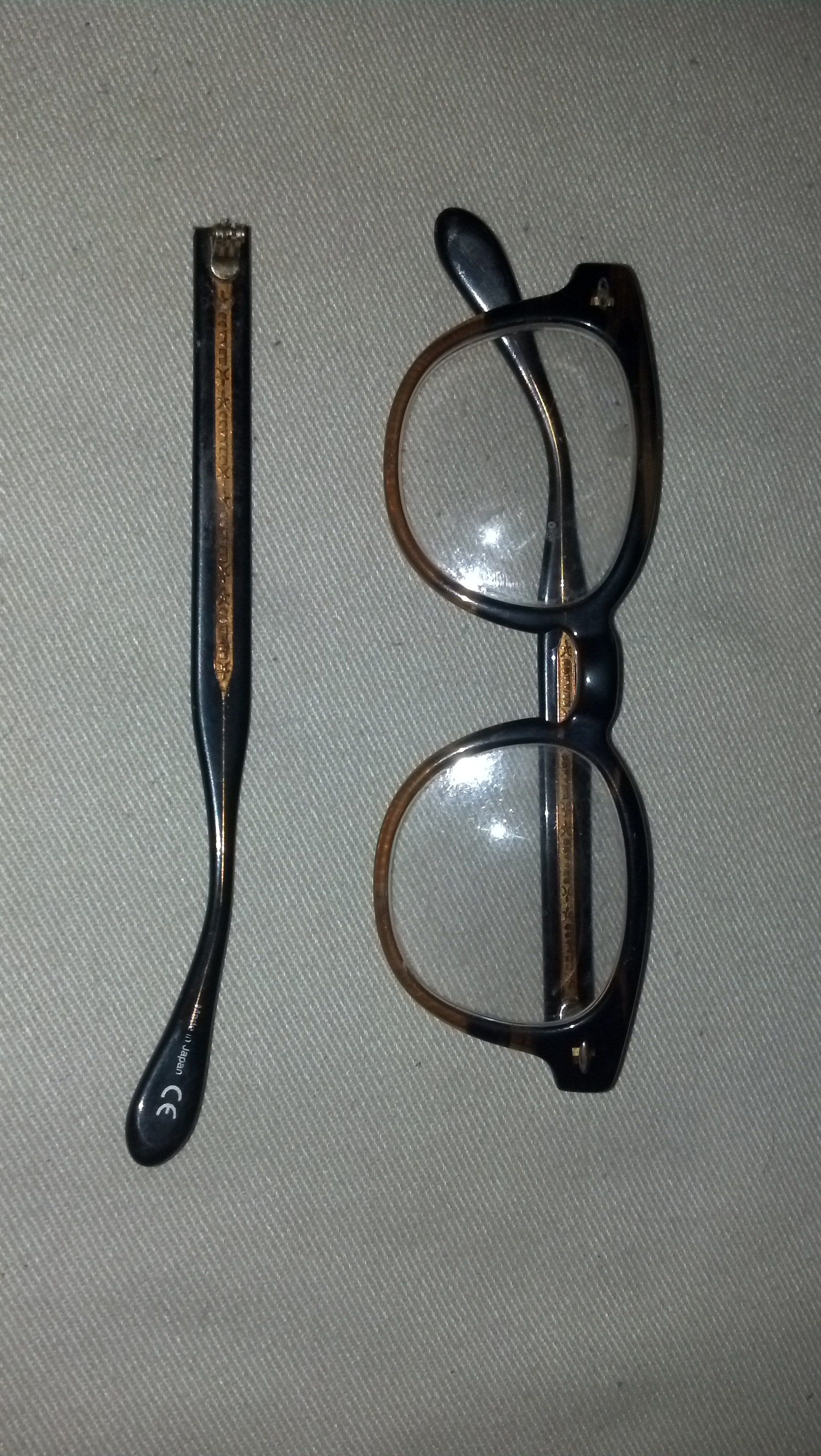 before shot of plastic eyeglasses with broken temple arm click on the link to see