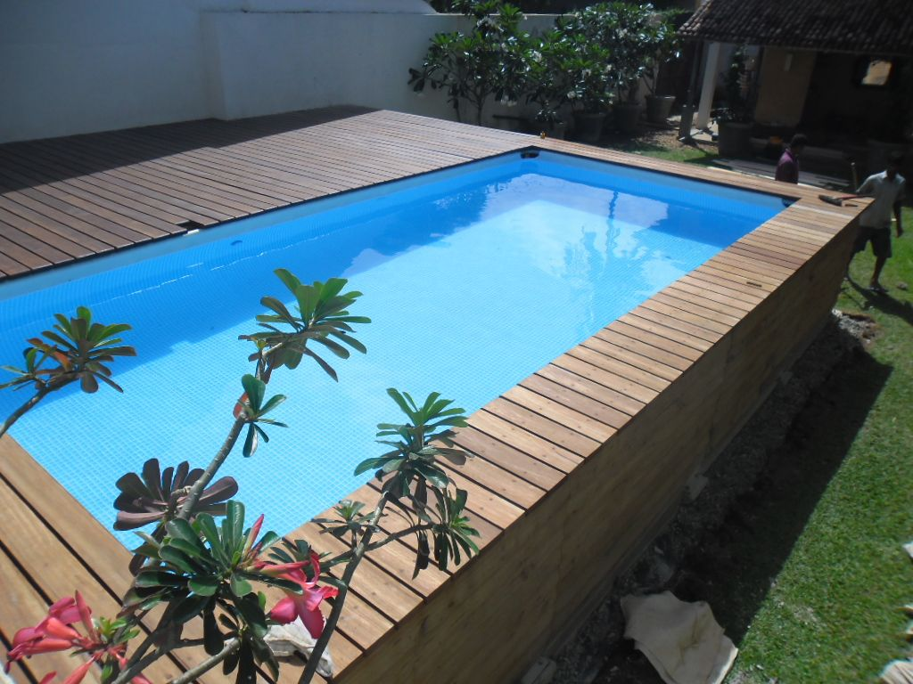 Pooldeck on intex above ground swimming pool 24 39 x12 39 x52 pool pinterest swimming pools for Rectangular above ground swimming pools with deck