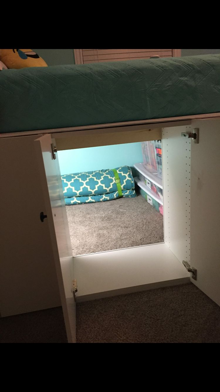 Awesome storage area under bed!! (Made with ikea kitchen cabinets)