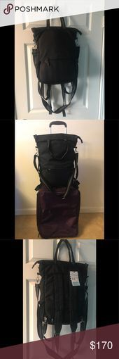 """NWT! Cynthia Rowley Backpack/Laptop/Travel Bag Travel Bag - can be used as tote... NWT! Cynthia Rowley Backpack/Laptop/Travel Bag Travel Bag - can be used as tote, crossbody, backpack, or trolley bag - black nylon, holds up to 15"""" laptop - 2 interior pockets - 2 water bottle holders - 2 top straps, adjustable cross-body strap - front zip pocket with key chain - silver hardware - zippered opening for top of suitcase/tr... #BackpackLaptopTravel #Bag #Cynthia #NWT #Rowley #Tote #travel"""