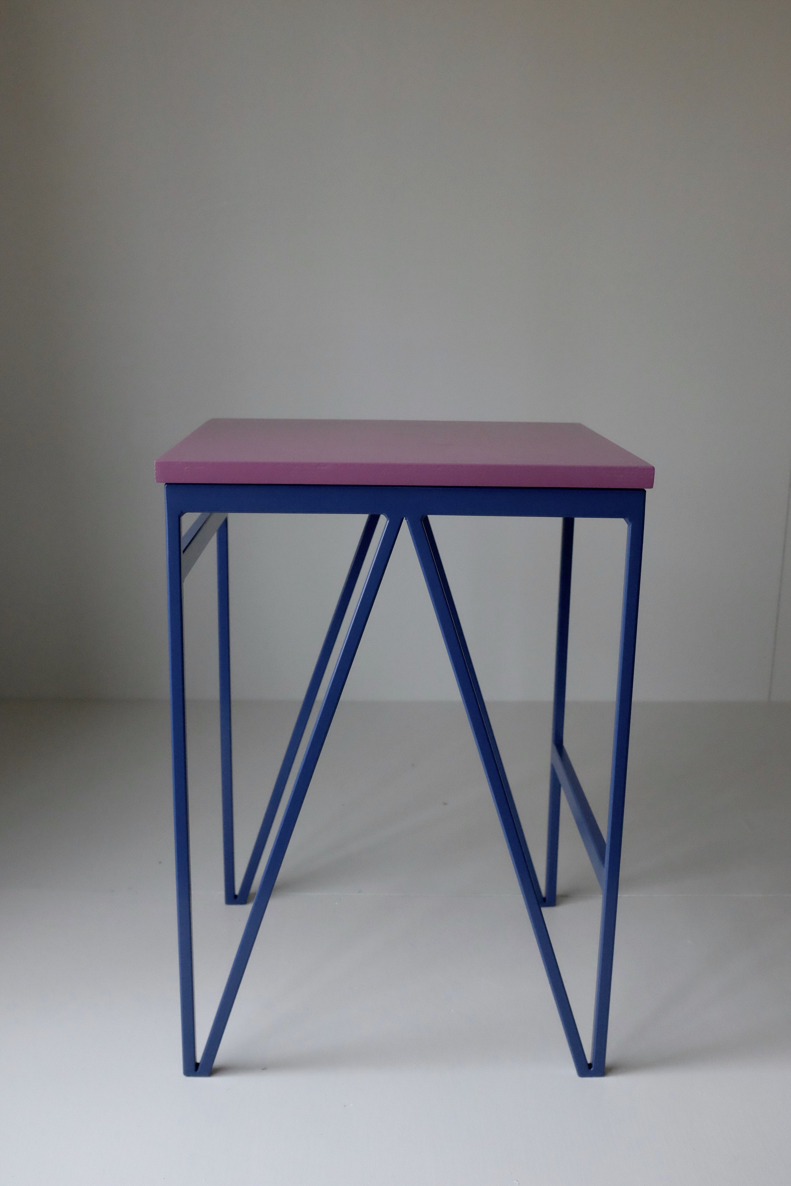 Blueberry powder coated steel frame and purple colour lacquered plywood top minimal modernbritishfurniture powdercoatedsteel stool
