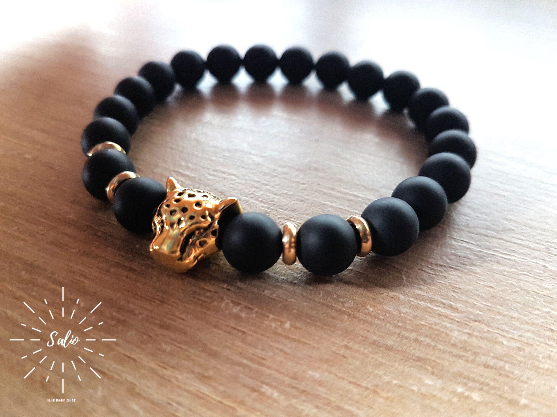 Menus matte black onyx bracelet with antique gold leopard head
