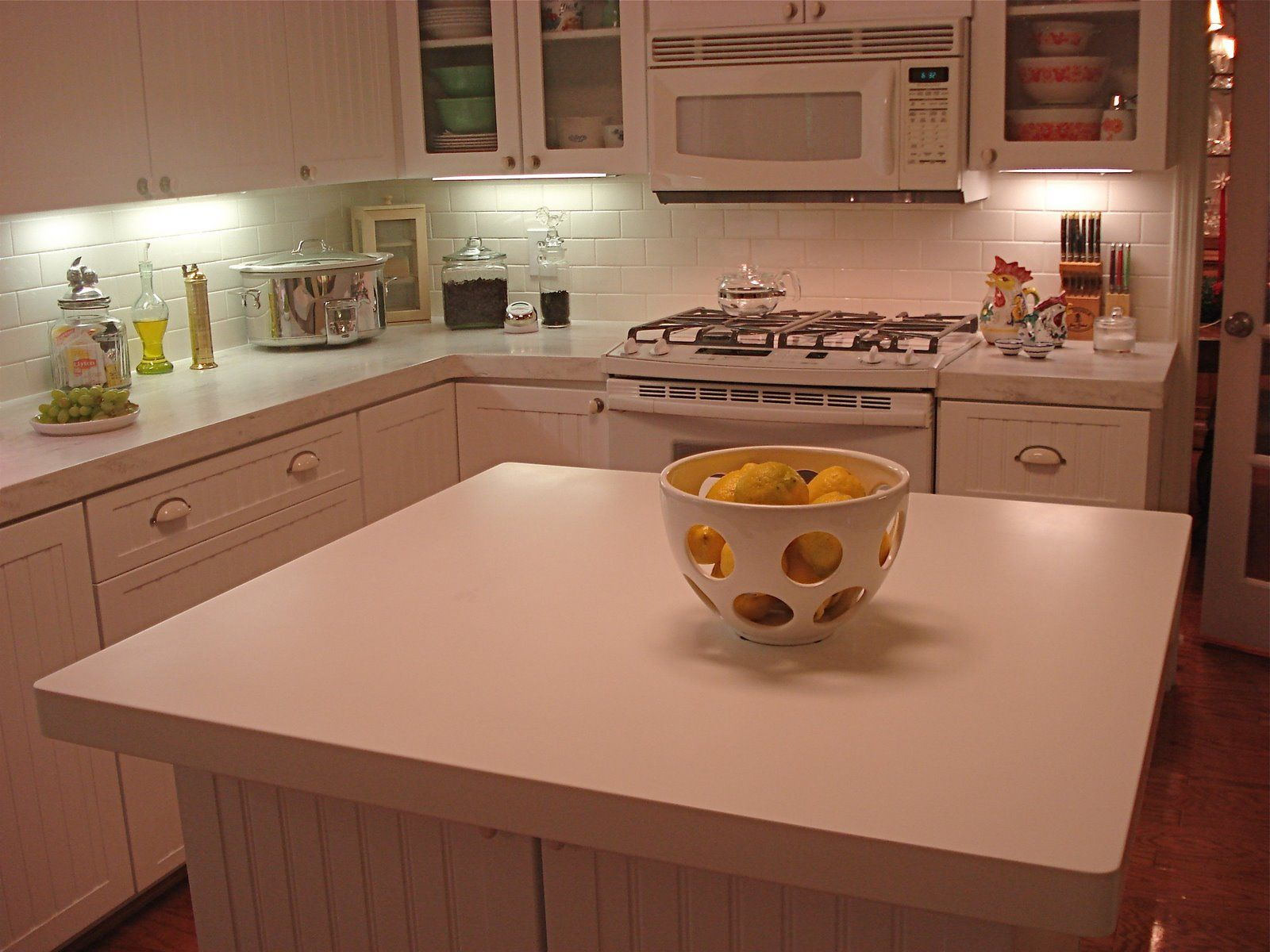 White Appliances And Corian Rain Cloud Countertops