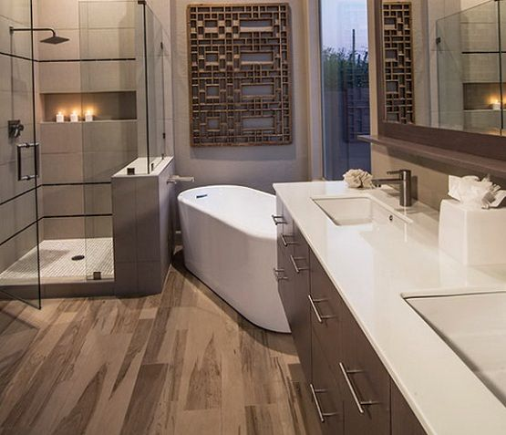 laminate flooring in bathroom with unique wall decor